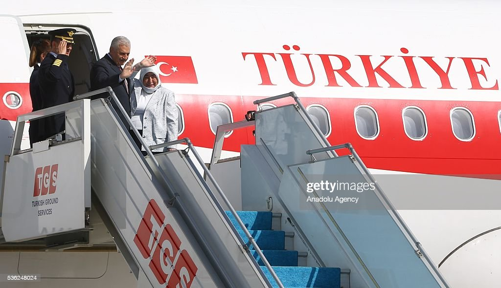 Turkish Prime Minister Binali Yildirim waves before departing for Turkish Republic of Northern Cyprus (TRNC) at Esenboga International Airport on June 01, 2015 in Ankara, Turkey.