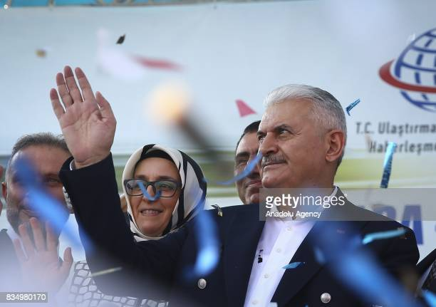Turkish Prime Minister Binali Yildirim waves people during a groundbreaking ceremony for a road construction in Kahramankazan district of Ankara...