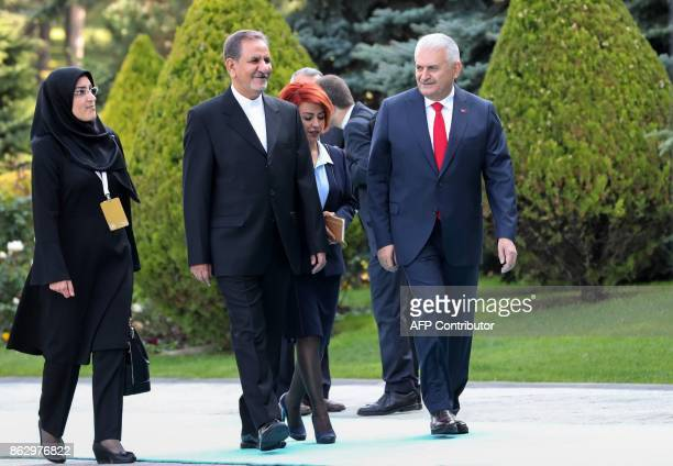 Turkish Prime Minister Binali Yildirim welcomes Iranian First Vice President Eshaq Jahangiri upon his arrival for their meeting at Cankaya Palace in...