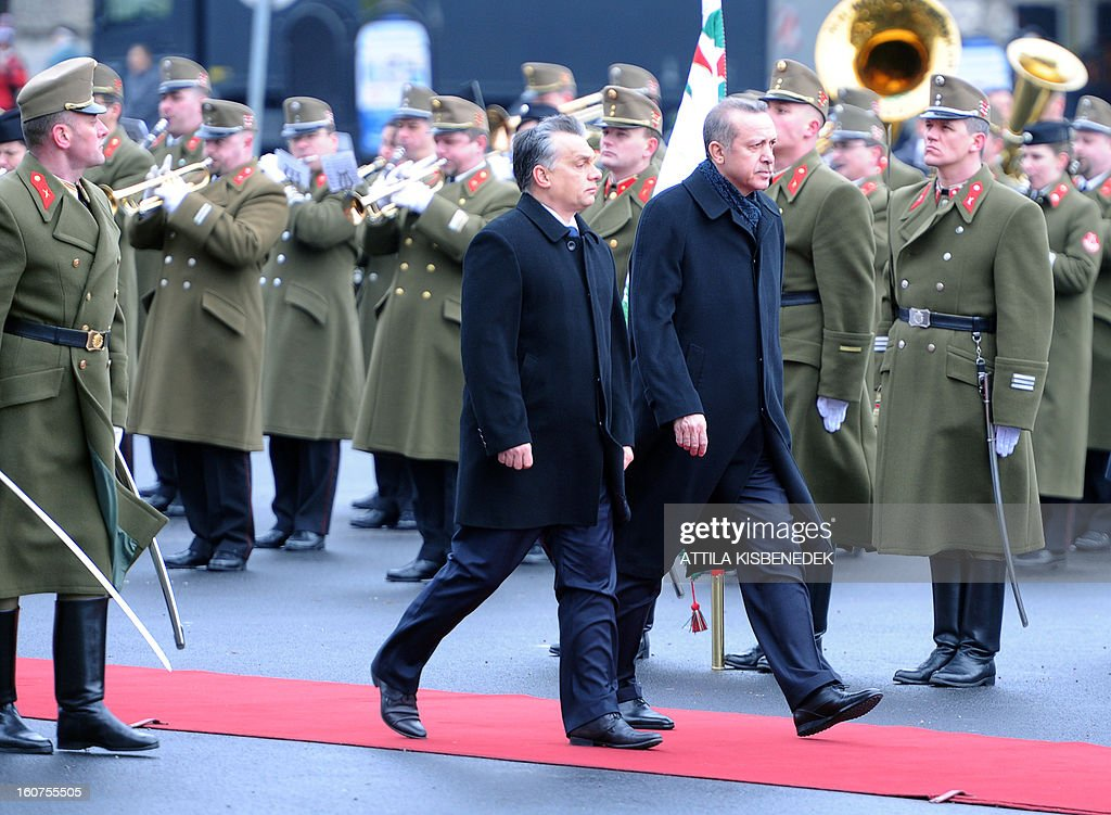 Turkish Prime Minister Recep Tayyip Erdogan (R) and his counterpart Viktor Orban (L) inspect the honour guard in front of the parliament in Budapest on February 5, 2013 during a welcoming ceremony. The Turkish guest is on a one-day official visit to the Hungarian capital.