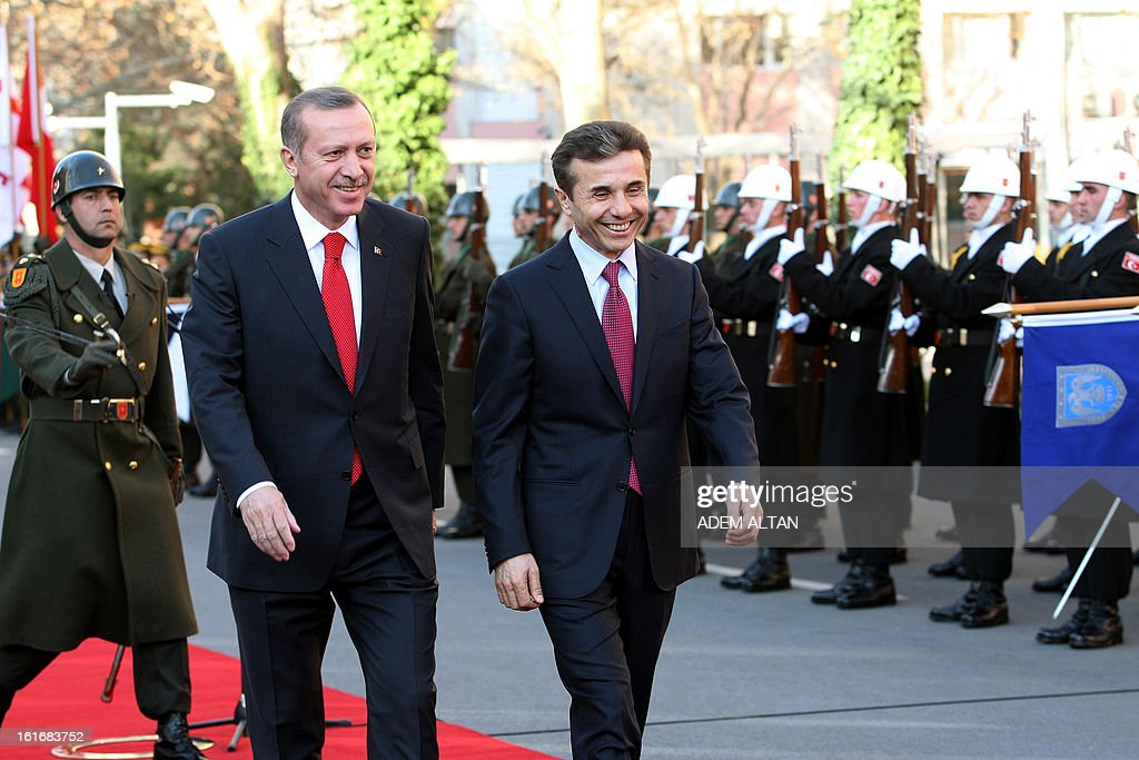 Turkish Prime Minister Recep Tayyip Erdogan (L) and his Georgian counterpart Bidzina Ivanishvili review the troops during a ceremony in Ankara on February 14, 2013.