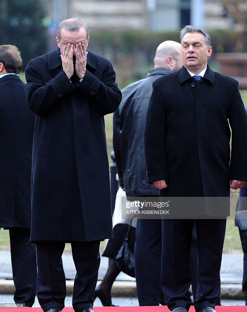 Turkish Prime Minister Recep Tayyip Erdogan (L) and his Hungarian counterpart Viktor Orban inspect the honour guard on February 5, 2013 in front of the parliament in Budapest during a welcoming ceremony. The Turkish guest is on a one-day official visit to the Hungarian capital.