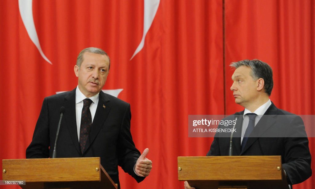 Turkish Prime Minister Recep Tayyip Erdogan (L) and his Hungarian counterpart Viktor Orban (R) attend a joint press conference in Delegation Hall of the parliament building in Budapest on February 5, 2013 after their plenary talks. The Turkish guest is on a one-day official visit to the Hungarian capital. AFP PHOTO / ATTILA KISBENEDEK