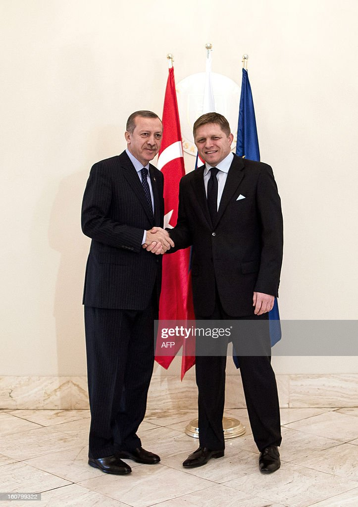 Turkish Prime Minister Recep Tayyip Erdogan (L) and his Slovakian counterpart Robert Fico shake hands on February 6, 2012 in Bratislava, Slovakia.