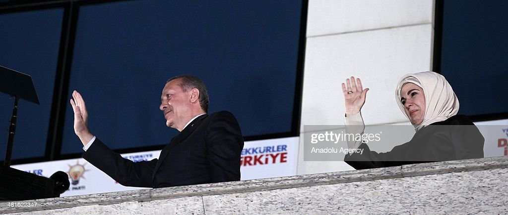 Turkish Prime Minister Recep Tayyip Erdogan (L) and his wife Emine Erdogan (R) greet the crowd from the balcony of the Justice and Development Party headquarters in Ankara, Turkey on March 31, 2014. According to early unofficial results, the ruling Justice and Development Party received 47 percent of the votes, with nearly 43 percent of ballot boxes having been opened across the country.