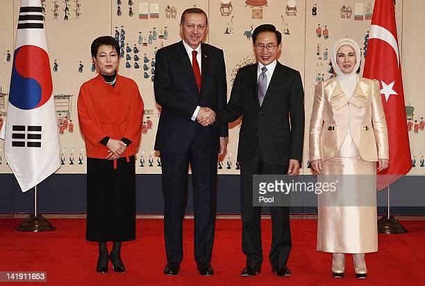 Turkish Prime Minister Recep Tayyip Erdogan and his wife Emine Erdogan South Korean President Lee Myung bak and his wife Kim Yoonok pose before their...