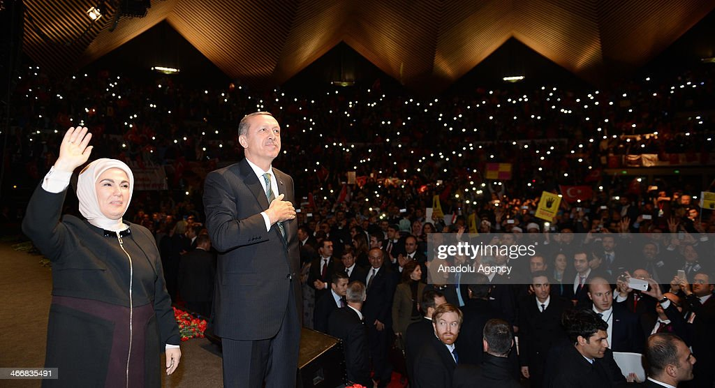Turkish Prime Minister Recep Tayyip Erdogan and his wife Emine Erdogan wave during the rally organized by the Union of European Turkish Democrats (UETD) at Tempodrom hall on February 4, 2014 in Berlin, Germany.