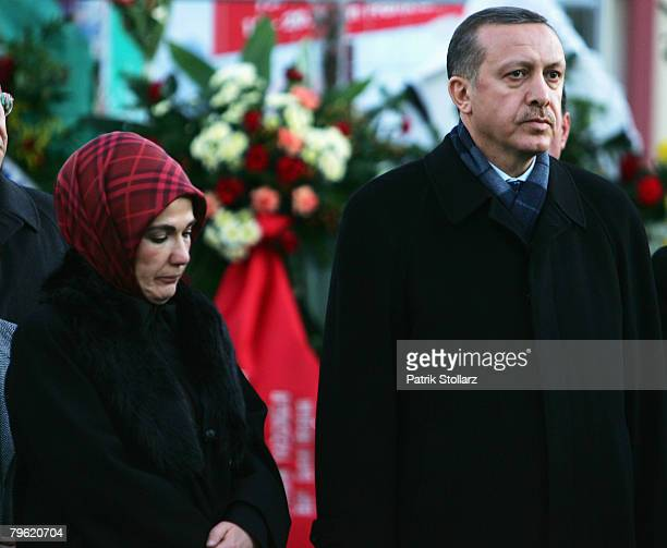Turkish Prime Minister Recep Tayyip Erdogan and his wife Ermine look on during a visit at the house which burned down on February 7 2008 in...
