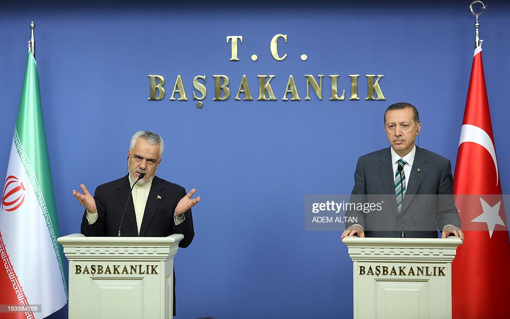 Turkish Prime Minister Recep Tayyip Erdogan (R) and Iran's first vice President Mohammad Reza Rahimi give a press conference in Ankara on October 4, 2012. AFP PHOTO / ADEM ALTAN