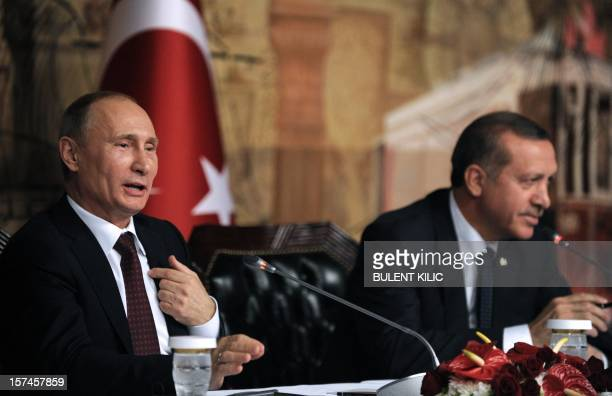 Turkish Prime Minister Recep Tayyip Erdogan and Russia's president Vladimir Putin gives a press conference in Istanbul on December 3 as part of...