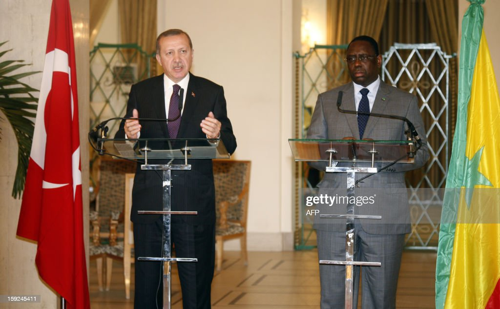 Turkish Prime Minister Recep Tayyip Erdogan (L) and Senegalese president Macky Sall (R) give a press conference after their meeting on January 10, 2013 in Dakar. Erdogan is on the second day of his visit to Senegal, part of a three-African-country tour. AFP PHOTO / MAMADOU TOURE BEHAN
