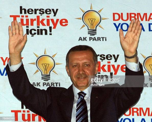 Turkish Prime Minister Recep Tayyip Erdogan celebrates the early results of the national elections in front of the party centre on July 22 2007 in...