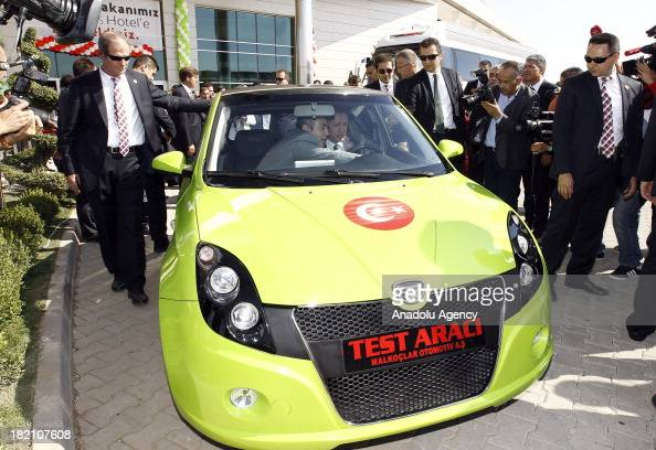 Turkish Prime Minister Recep Tayyip Erdogan drives Turkey's first electric car on Saturday September 28 in Kirsehir Province in Turkey's Central...