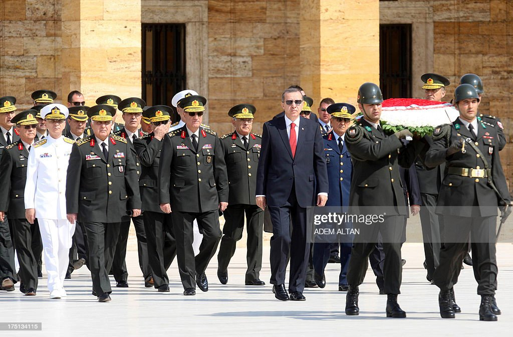 Turkish Prime Minister Recep Tayyip Erdogan (4th R) follows a military honour guard at the mausoleum of Mustafa Kemal Ataturk, founder of modern Turkey, before a meeting of the High Military Council in Ankara on August 1, 2013.