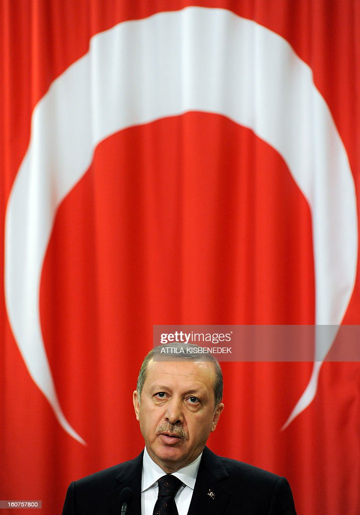 Turkish Prime Minister Recep Tayyip Erdogan gives a press conference at the parliament building in Budapest on February 5, 2013. Erdogan is on a one-day official visit to the Hungarian capital. AFP PHOTO / ATTILA KISBENEDEK