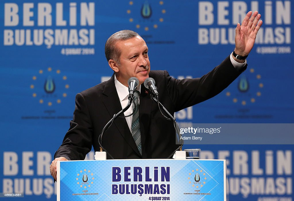 Turkish Prime Minister <a gi-track='captionPersonalityLinkClicked' href=/galleries/search?phrase=Recep+Tayyip+Erdogan&family=editorial&specificpeople=213890 ng-click='$event.stopPropagation()'>Recep Tayyip Erdogan</a> greets supporters at a rally at Tempodrom hall on February 4, 2014 in Berlin, Germany. Turkey will soon face parliamentary elections and Erdogan is vying for the votes of expatriate Turks. Berlin has the highest Turkish population of any city outside of Turkey.