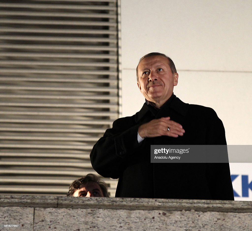 Turkish Prime Minister Recep Tayyip Erdogan greets the crowd from the balcony of the Justice and Development Party headquarters in Ankara, Turkey on March 31, 2014. According to early unofficial results, the ruling Justice and Development Party received 47 percent of the votes, with nearly 43 percent of ballot boxes having been opened across the country.
