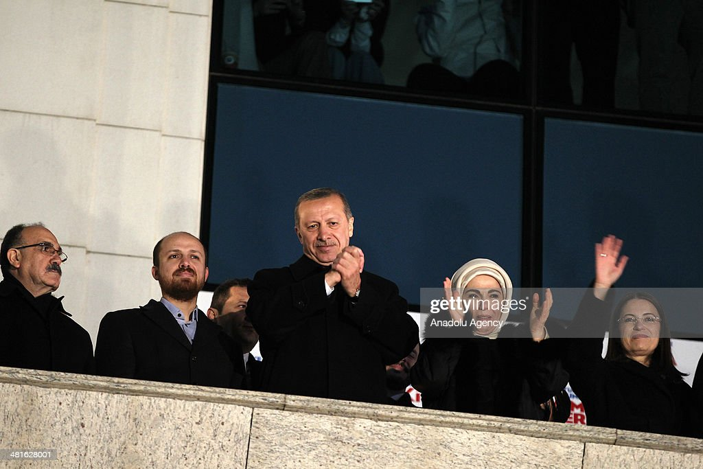 Turkish Prime Minister Recep Tayyip Erdogan (C) greets the crowd from the balcony of the Justice and Development Party headquarters in Ankara, Turkey on March 31, 2014. Erdogan's wife Emine Erdogan (2nd R), his son Bilal Erdogan (2nd L), The Minister of Family and Social Policies Aysenur Islam (R) and deputy Prime Minister Besir Atalay (2nd L) accompany Turkish PM during his speech. According to early unofficial results, the ruling Justice and Development Party received 47 percent of the votes, with nearly 43 percent of ballot boxes having been opened across the country.