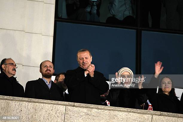 Turkish Prime Minister Recep Tayyip Erdogan greets the crowd from the balcony of the Justice and Development Party headquarters in Ankara Turkey on...