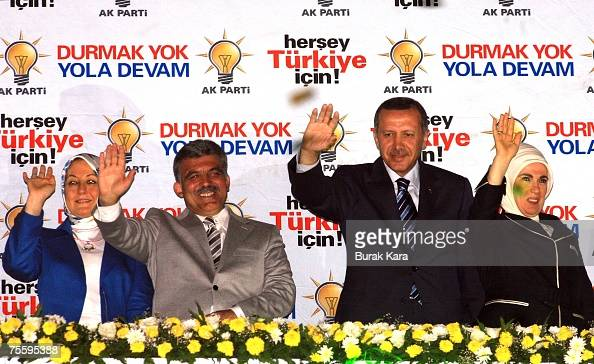 Turkish Prime Minister Recep Tayyip Erdogan his wife Emine Erdogan Foreign Minister Abdullah Gul and his wife Hayrunisa Gul celebrate the early...