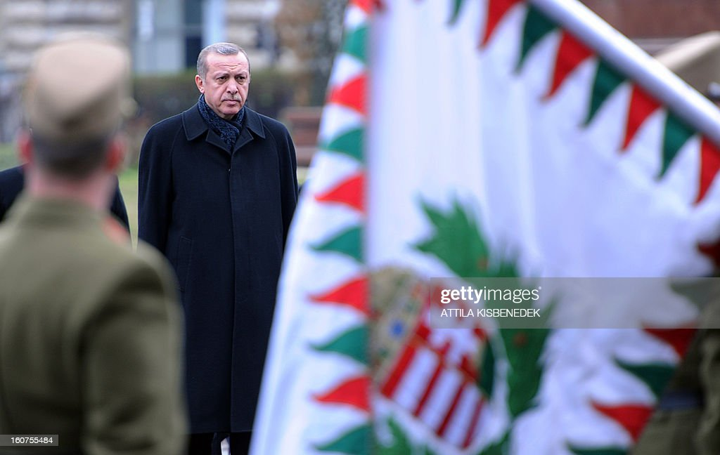 Turkish Prime Minister Recep Tayyip Erdogan inspects the honour guard with his Hungarian counterpart in front of the parliament in Budapest on February 5, 2013 during a welcoming ceremony. The Turkish guest is on a one-day official visit to the Hungarian capital.