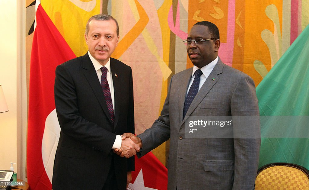 Turkish Prime Minister Recep Tayyip Erdogan (L) is greeted by Senegalese president Macky Sall (R) on January 10, 2013 in Dakar. Erdogan is on the second day of his visit to Senegal, part of a three-African-country tour.