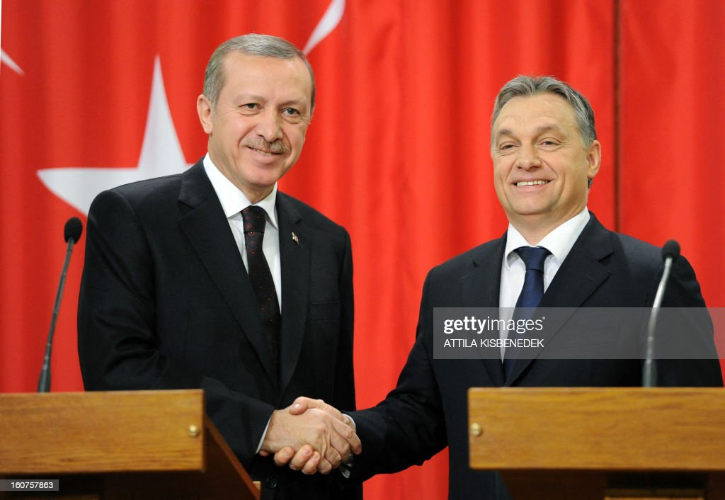 Turkish Prime Minister Recep Tayyip Erdogan (L) is welcomed by his Hungarian counterpart Viktor Orban (R) after their joint press conference in Delegation Hall of the parliament building in Budapest on February 5, 2013 after their plenary talks. The Turkish guest is on a one-day official visit to the Hungarian capital. AFP PHOTO / ATTILA KISBENEDEK