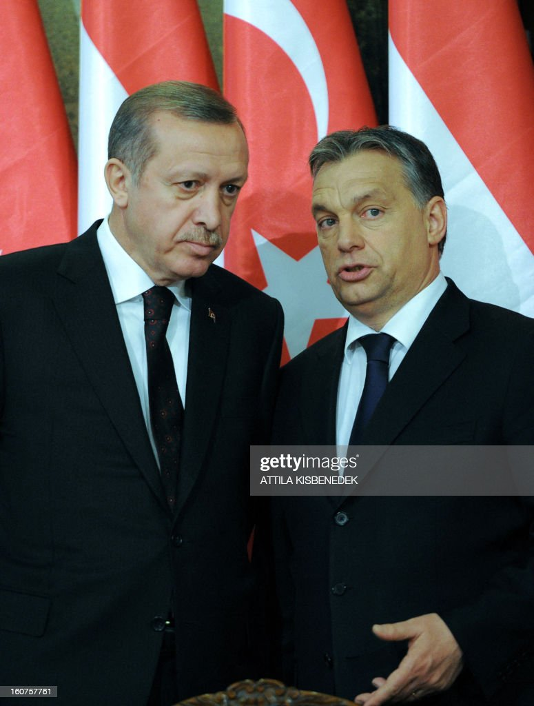 Turkish Prime Minister Recep Tayyip Erdogan (L) listens to his Hungarian counterpart Viktor Orban (R) prior to their joint press conference in Delegation Hall of the parliament building in Budapest on February 5, 2013 after their plenary talks. The Turkish guest is on a one-day official visit to the Hungarian capital.