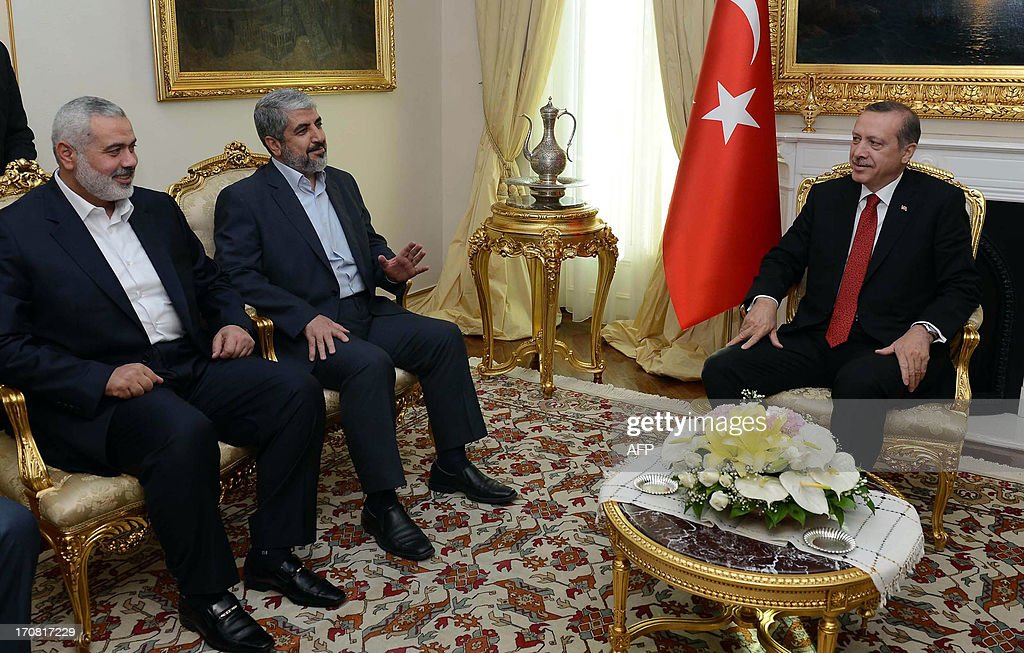 Turkish Prime Minister Recep Tayyip Erdogan (R) meets Khalid Mashaal (C), the Hamas chief in exile, and Gazas prime minister Ismail Haniyeh in Ankara on June 18, 2013. Senior leaders of the Palestinian Islamist movement Hamas met today in Ankara with Turkish Prime Minister Erdogan to discuss Erdogan's planned visit to the Gaza Strip as well as the situation in Syria, the source said on condition of anonymity. AFP PHOTO/ PRIME MINISTER PRESS OFFICE/ YASIN BULBUL == RESTRICTED TO EDITORIAL USE - MANDATORY CREDIT 'PRIME MINISTER PRESS OFFICE' - NO