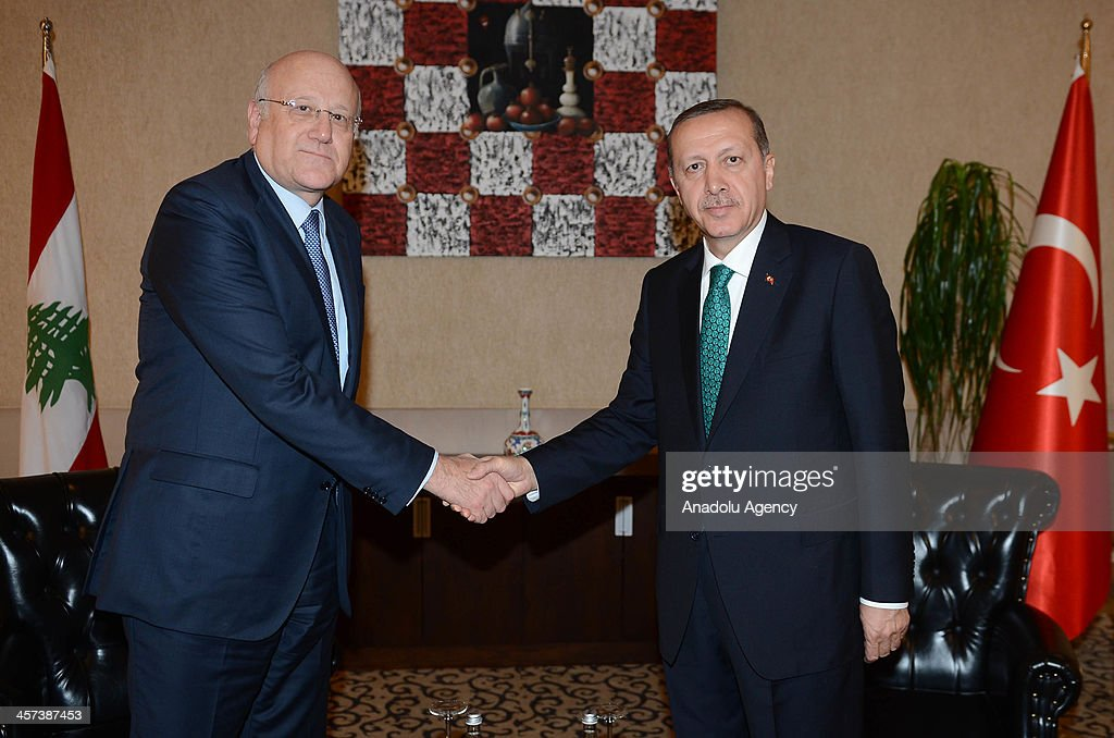 Turkish Prime Minister Recep Tayyip Erdogan (R) meets with Lebanese Prime Minister Najib Mikati (L) ahead of the 'Seb-i Arus' (the night of union) ceremony on December 17,2013 in the central Turkish province of Konya. The Turkish and Labanese premiers are set to attend a ceremony to commemorate the 740th anniversary of Sufi mystic Mevlana Jalaluddin Rumis passing, known as 'Seb-i Arus' (the night of union), in Konya.