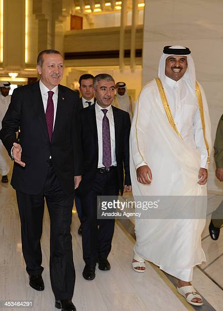 Turkish Prime Minister Recep Tayyip Erdogan meets with Qatar's Emir Sheikh Tamim bin Hamad alThani as part of his Doha visit on December 4 2013 in...