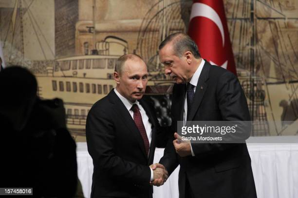 Turkish Prime Minister Recep Tayyip Erdogan receives Russian President Vladimir Putin on December 3 2012 in Istanbul Turkey Putin has travelled to...