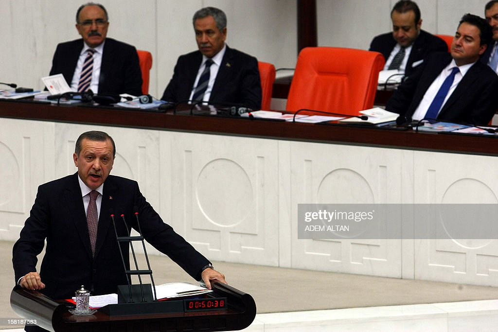 Turkish Prime Minister Recep Tayyip Erdogan (L) responds to critics at the parliament on December 10, 2012 as lawmakers debate the government's 2013 budget in Ankara.