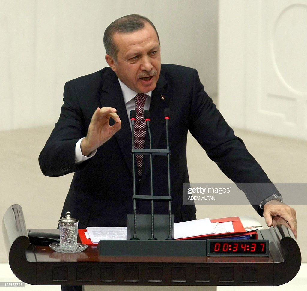 Turkish Prime Minister Recep Tayyip Erdogan responds to critics at the parliament on December 10, 2012 as lawmakers debate the government's 2013 budget in Ankara.