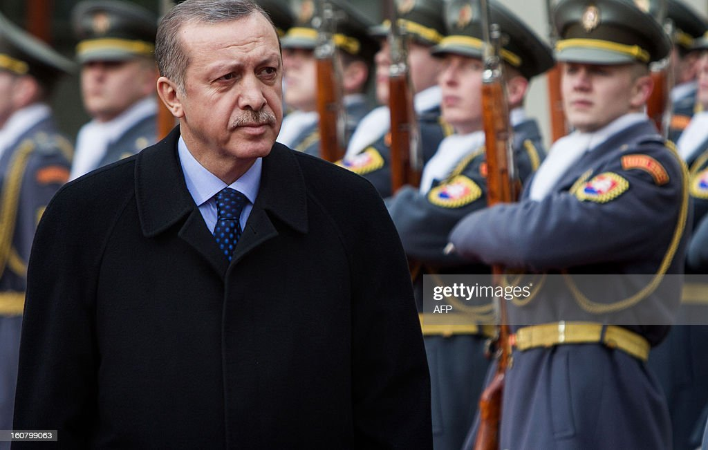 Turkish Prime Minister Recep Tayyip Erdogan reviews a guard of honor with his Slovakian counterpart Robert Fico (unseen) on February 6, 2012 in Bratislava, Slovakia.