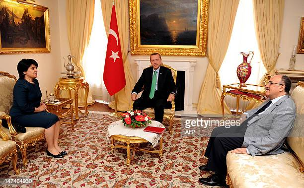 CREDIT 'AFP PHOTO / TURKISH PRIME MINISTER OFFICE / KAYHAN OZER' NO Turkish Prime Minister Recep Tayyip Erdogan sits during a meeting with his deputy...