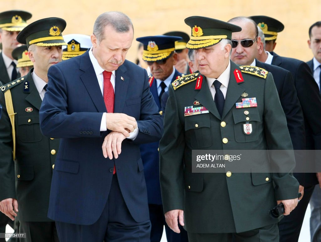 Turkish Prime Minister Recep Tayyip Erdogan (L) speaks to Chief of Staff General Necdet Ozel at the mausoleum of Mustafa Kemal Ataturk, founder of modern Turkey, before a meeting of the High Military Council in Ankara on August 1, 2013. AFP PHOTO / ADEM ALTAN