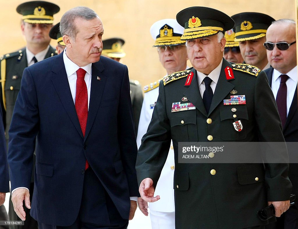 Turkish Prime Minister Recep Tayyip Erdogan (L) speaks to Chief of Staff General Necdet Ozel at the mausoleum of modern Turkey's founder Mustafa Kemal Ataturk before a meeting of the High Military Council in Ankara on August 1, 2013. AFP PHOTO / ADEM ALTAN