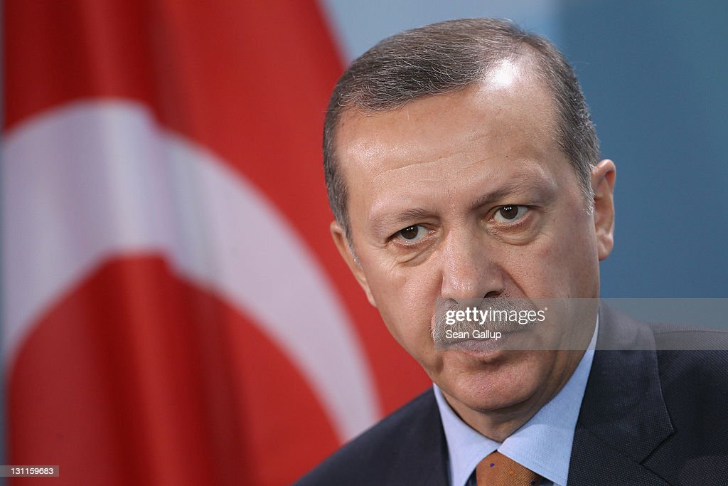 Turkish Prime Minister <a gi-track='captionPersonalityLinkClicked' href=/galleries/search?phrase=Recep+Tayyip+Erdogan&family=editorial&specificpeople=213890 ng-click='$event.stopPropagation()'>Recep Tayyip Erdogan</a> speaks to the media following talks with German Chancellor Angela Merkel at the Chancellery on November 2, 2011 in Berlin, Germany. Earlier in the day the two leaders attended a celebration to mark 50 years of Turkish immigration to Germany. On October 30, 1961 Turkey and what was then West Germany signed an agreement that paved the way for the migration of Turkish 'guest workers' to Germany. Germany in the early 1960s, which in many ways was still recovering from the devastation of World War II, required foreign labour to fill its industrial workforce, and the influx of immigrants from Turkey, Italy, Greece and other south European countries made Germany's 'economic miracle' possible. Today large numbers of Germans with Turkish roots are an integral part of German society, though integration and assimilation remain a contentious issue, especially for more recent Turkish immigrants.