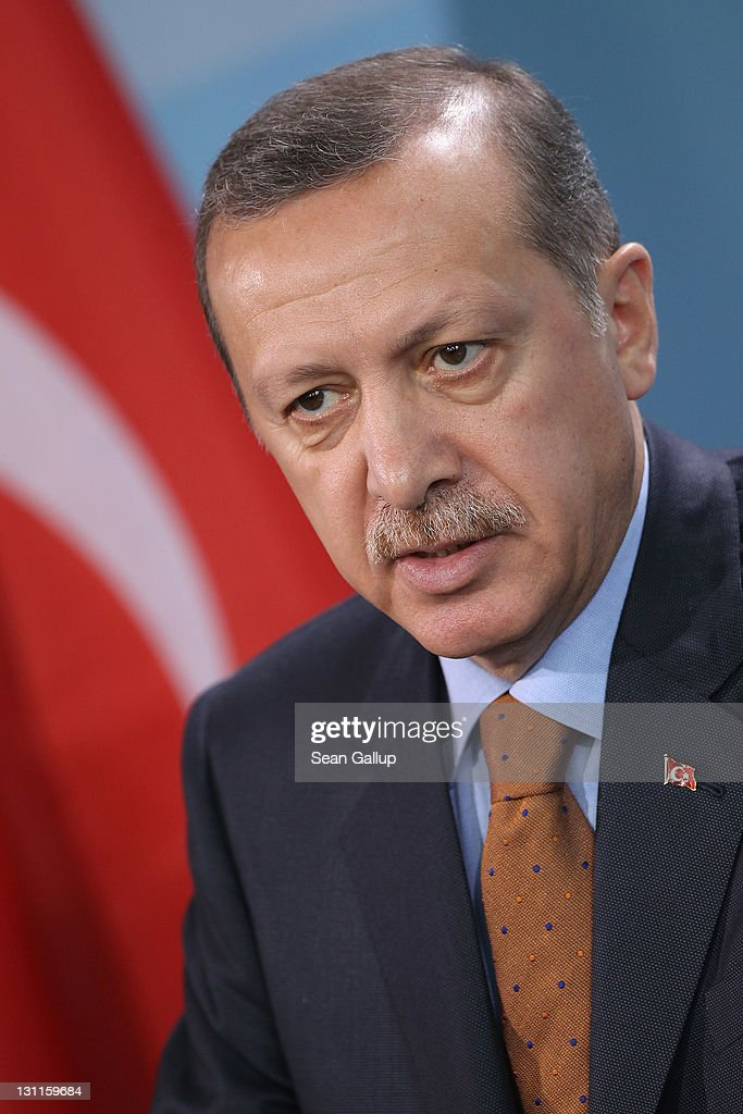 Turkish Prime Minister Recep Tayyip Erdogan speaks to the media following talks with German Chancellor Angela Merkel at the Chancellery on November 2...