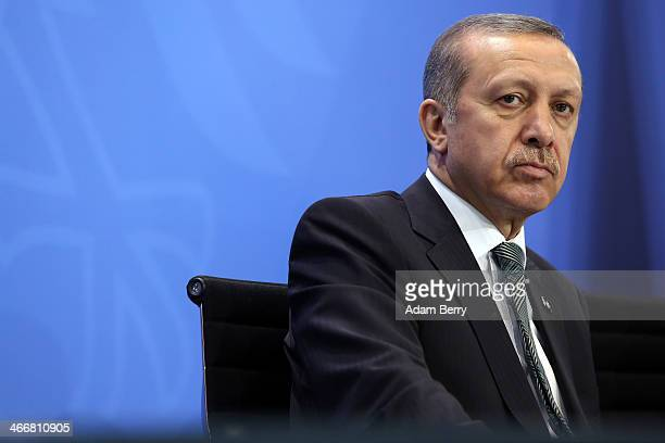 Turkish Prime Minister Recep Tayyip Erdogan speaks to the media following talks with German Chancellor Angela Merkel at the German federal...