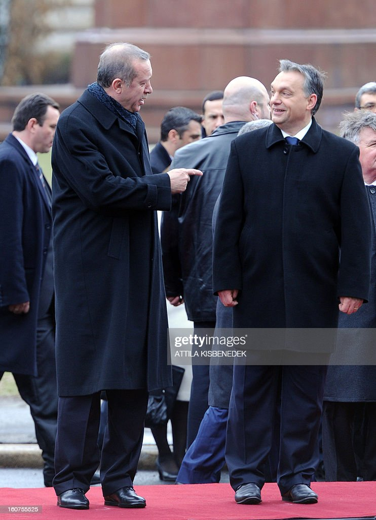 Turkish Prime Minister Recep Tayyip Erdogan (L) talks with his Hungarian counterpart Viktor Orban on February 5, 2013 in front of the parliament in Budapest during a welcoming ceremony. The Turkish guest is on a one-day official visit to the Hungarian capital.