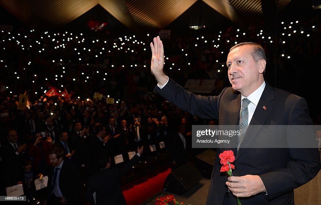 Turkish Prime Minister Recep Tayyip Erdogan waves during the rally organized by the Union of European Turkish Democrats (UETD) at Tempodrom hall on February 4, 2014 in Berlin, Germany.