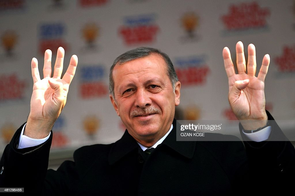 Turkish Prime Minister Recep Tayyip Erdogan waves the four finger sign of rabia during a rally of the Justice and Development Party in the Kartal district at the asia side of Istanbul on March 29, 2014. Turkey gears up for local elections on March 30 ahead of a presidential vote in six months and parliamentary polls next year. Erdogan and his Islamic-leaning party, after over a decade in power, face the first electoral test following months of political turmoil, with mass street protests and a corruption scandal spread via Twitter, Facebook and YouTube. Amid an atmosphere of distrust ahead of tomorow's election with over 50 million eligible voters, the CHP and tens of thousands of citizen volunteers plan to monitor the ballot count.