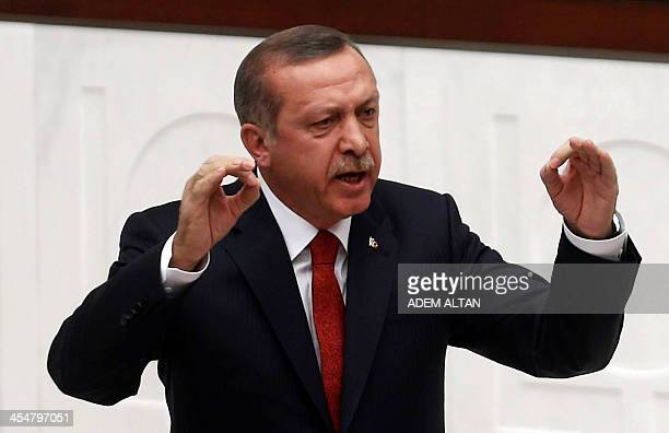 Turkish Prime Minister Tayyip Erdogan delivers a speech as lawmakers debate his government's budget proposal during a parliament session in Ankara on...