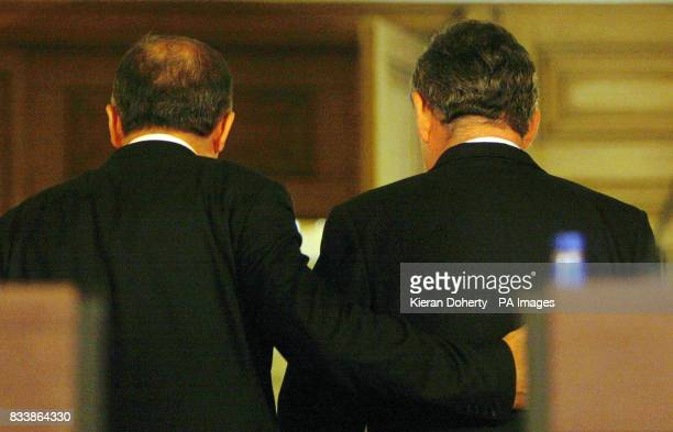 Turkish Prime Minister Tayyip Erdogan puts his hand on Britain's Prime Minister Gordon Brown's back as they leave a news conference in 10 Downing...