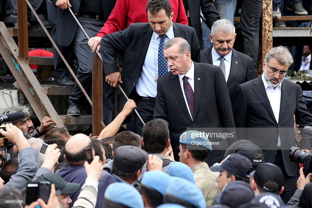 Turkish Prime Minister Tayyip Erdogan visits the scene after a coal mine explosion on May 14 2014 in Soma Manisa Turkey Rescuers pulled more dead and...