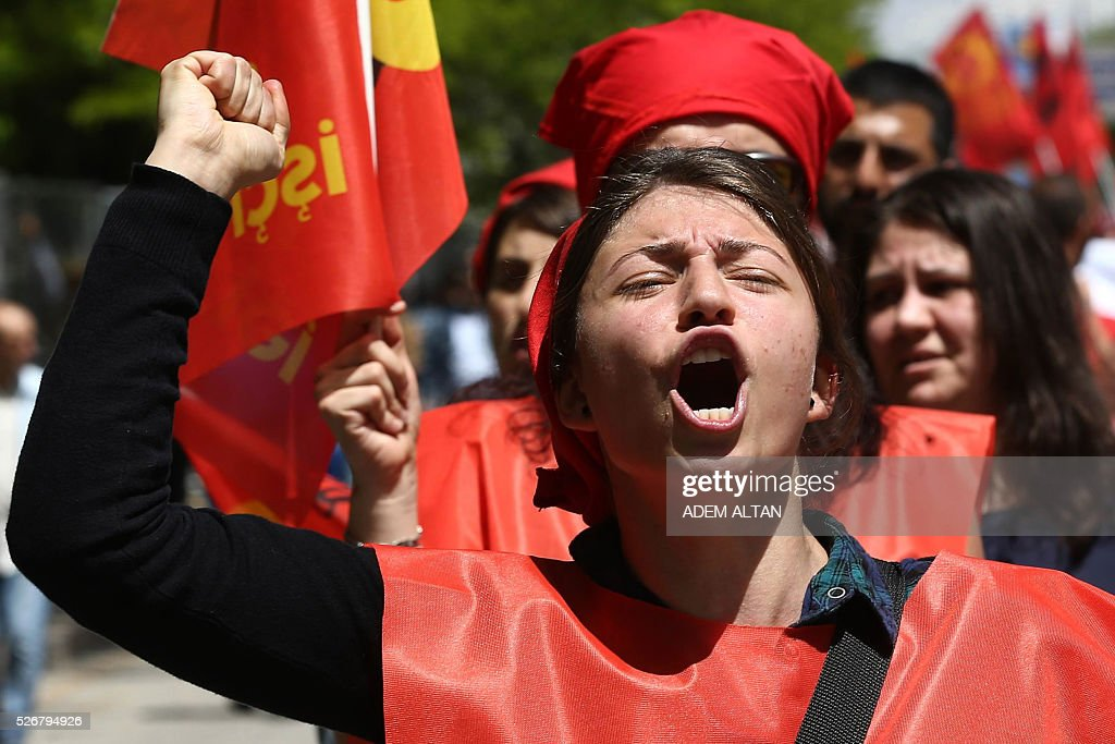 A Turkish protester shouts slogans during a May Day rally organised by labour unions in Ankara on May 1, 2016. / AFP / ADEM