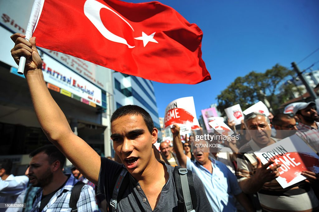 A Turkish protester waves his national flag as anti-regime demonstrators march to the district of Kadikoy in Istanbul on September 15, 2013. Several people have been killed in clashes with riot police since demonstrations against the government of Prime Minister Recep Tayyip Erdogan, seen as increasingly authoritarian, began in June.