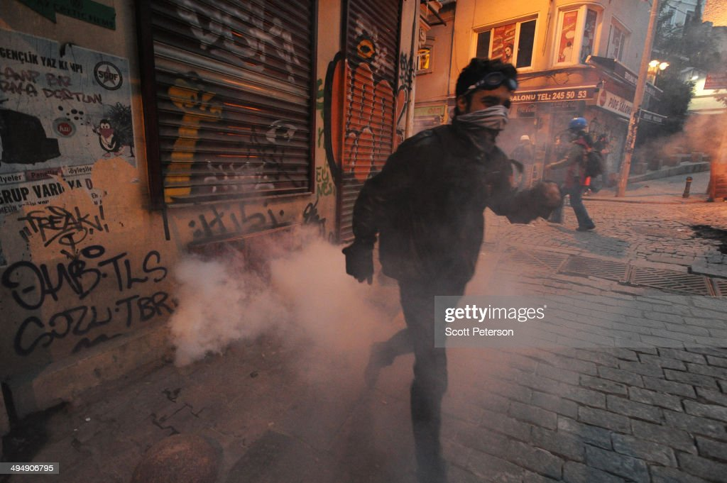 Turkish protesters battle police amid tear gas to mark the one-year anniversary of the Gezi Park protests on May 31, 2014 in Istanbul, Turkey. The original protest over the removal of trees to convert a downtown park into a shopping mall turned into a broader, month-long protest against the authoritarian rule of Turkish Prime Minister Recep Tayyip Erdogan, presenting the political biggest challenge to the PM and his ruling AK Party (AKP) after more than a decade in power.